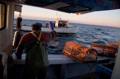 Prince_Edward_Island_lobster_fisherman_on_boat_waving_goodbye_to_second_boat_225674.jpg